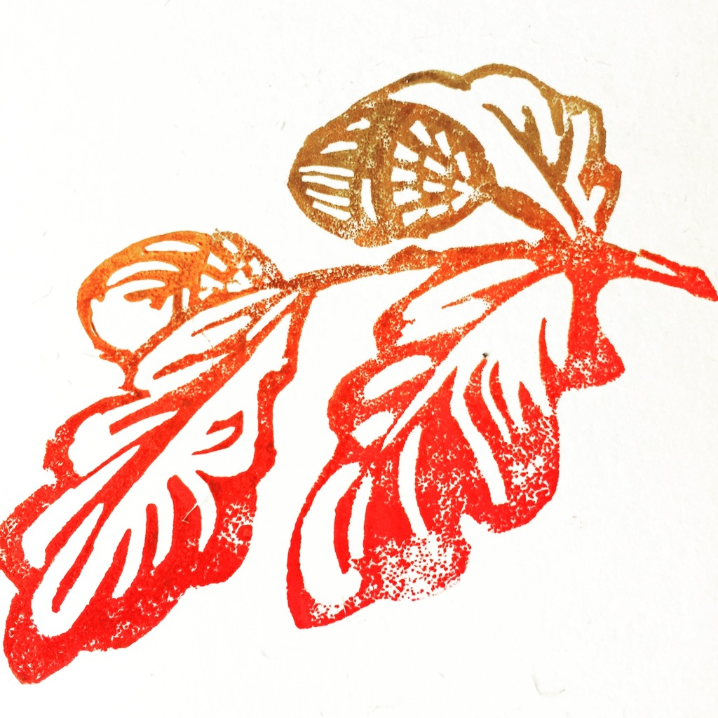 Artwork showing a simple linocut of acorns