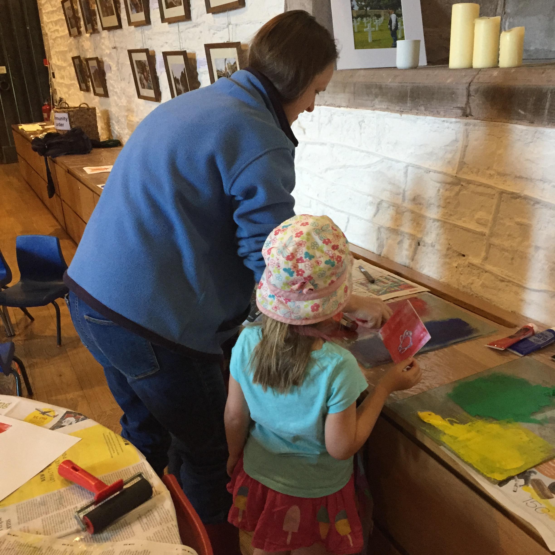 Photo of mum and daughter taking part in a print workshop run by Skirrid Print Studio at the Hub in Peterchurch - printing designs of moths