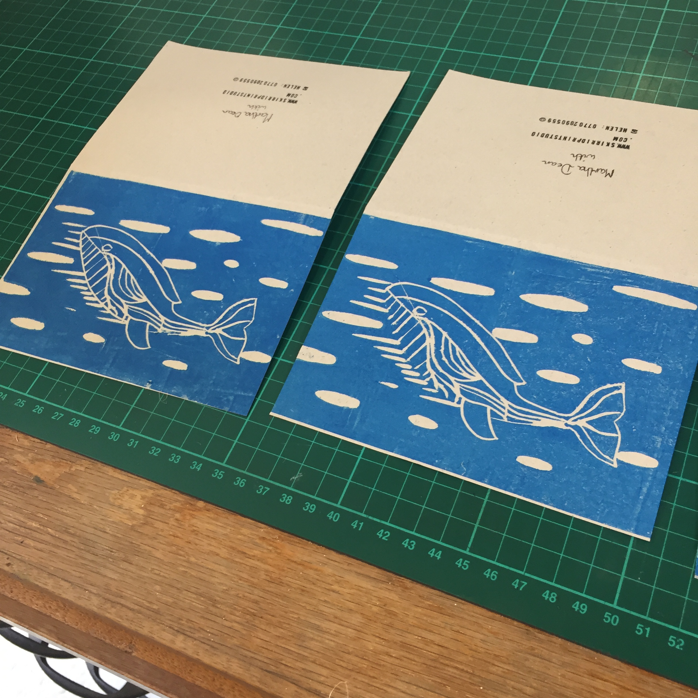 Photo of 2 A6 linocut cards made at Skirrid Print Studio.