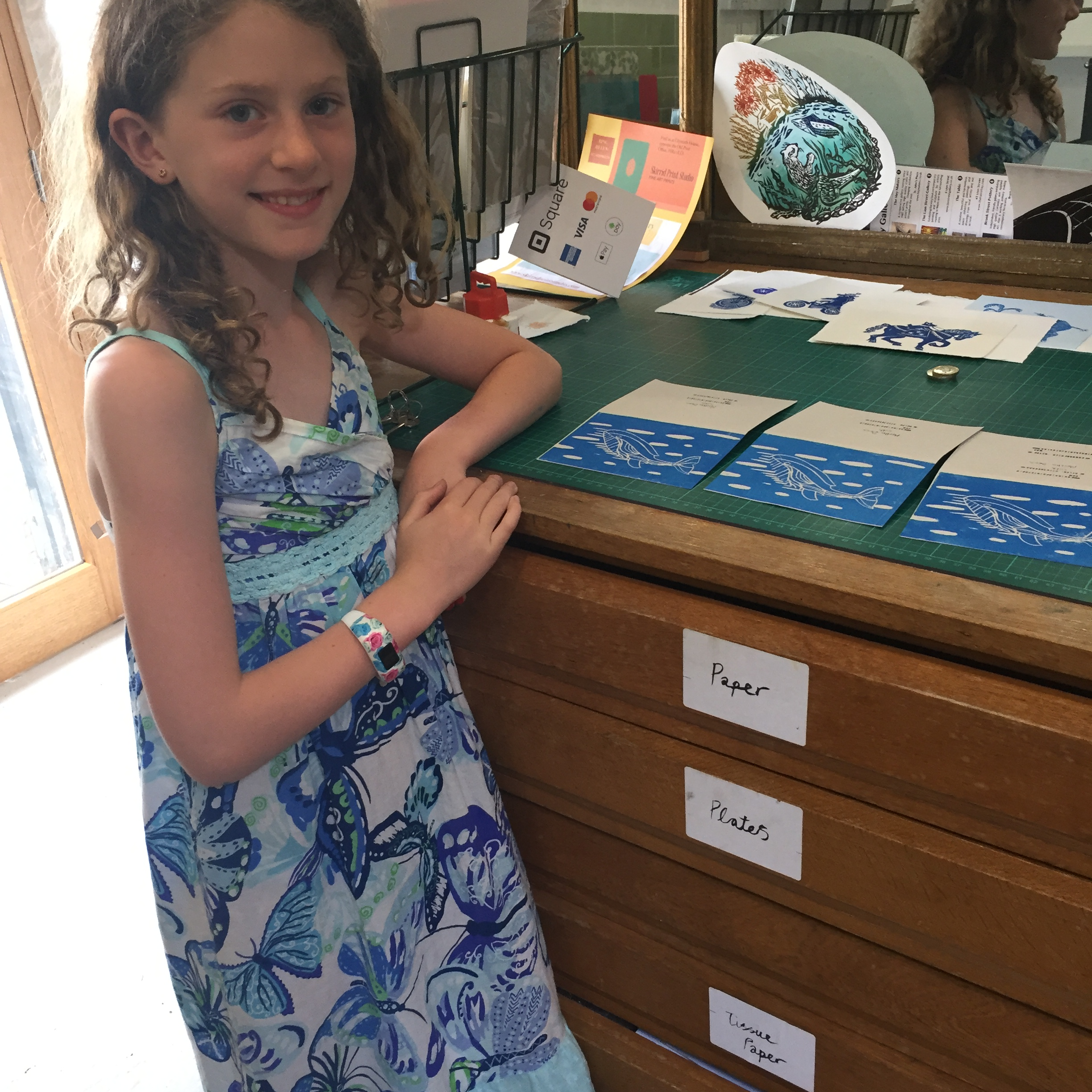 Child in Skirrid Print Studio -showing her work