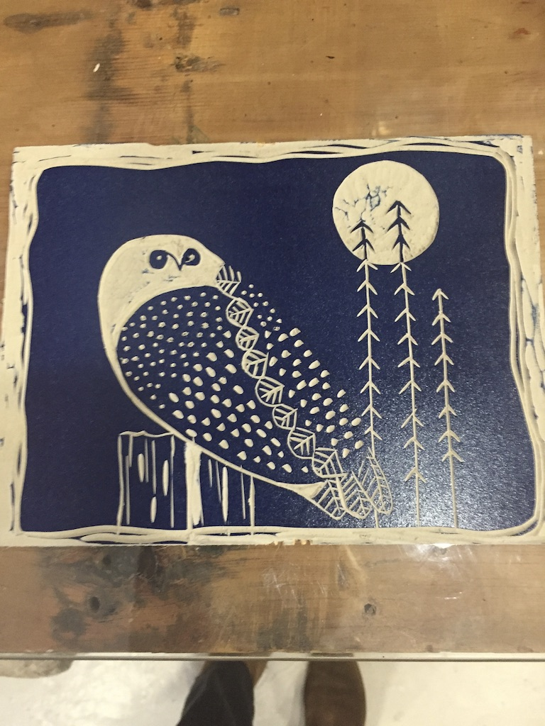 Inked lino plate showing an owl and moon