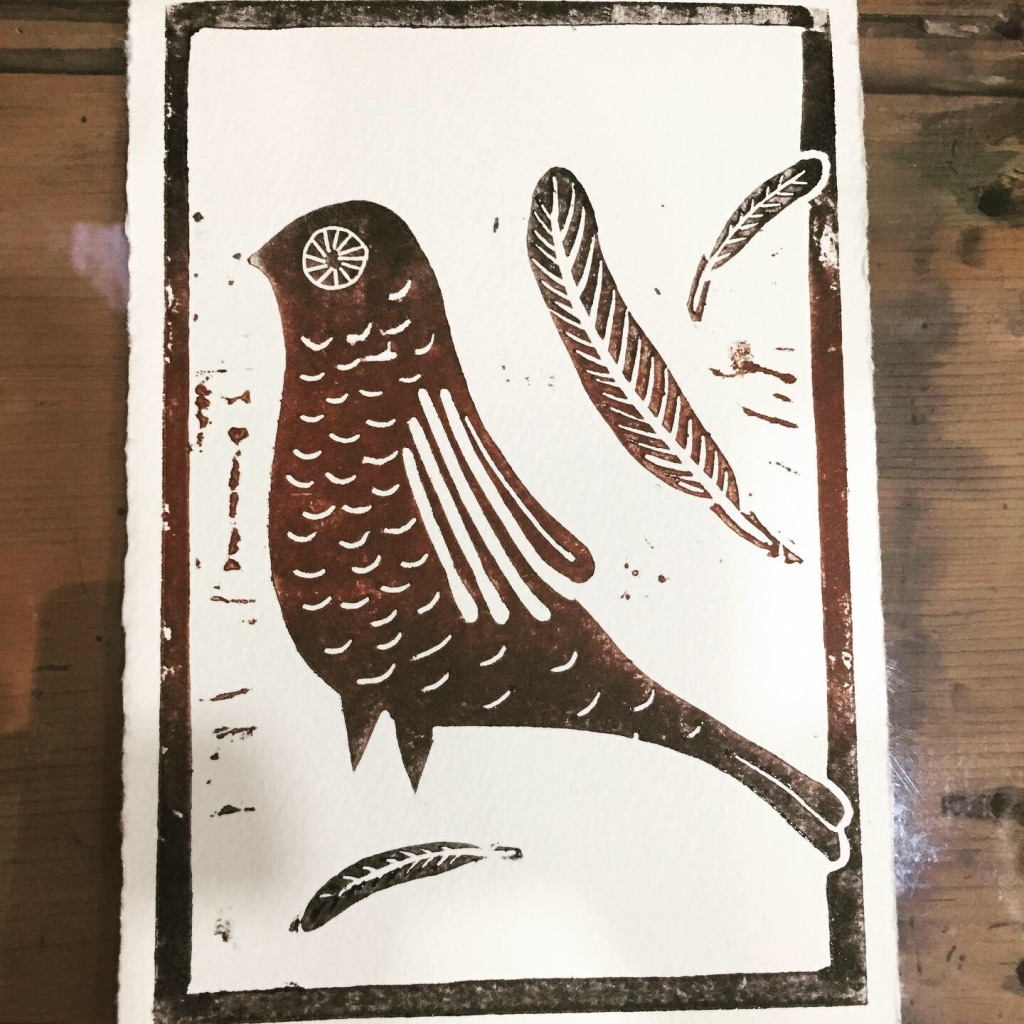 Linocut print of an A6 design